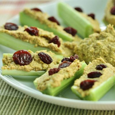 Celery Sticks with Curried Sunflower Spread and Raisins